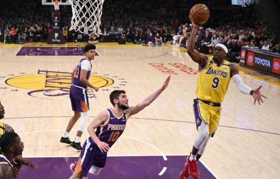 Photo of Rajon Rondo, Anthony Davis lideran a Lakers, que aplastan a Suns