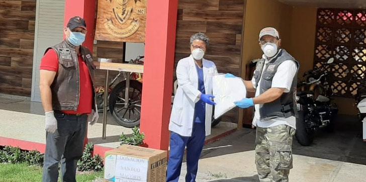 Photo of Grupo motorizado de la capital dona 50 trajes de bioseguridad al hospital de SFM